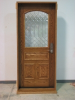 Wood door with leaded glass window