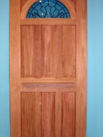 Wood door with leaded glass arched window
