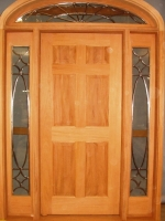 Panel door with arched transom and glass sidelites