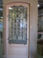 Wood door with iron grill